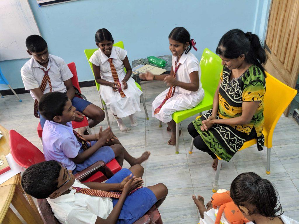 Geetha Moorthy teaches a group of young children in Killinochi, Sri Lanka.